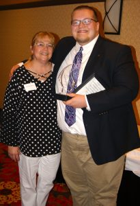 woman with man holding award