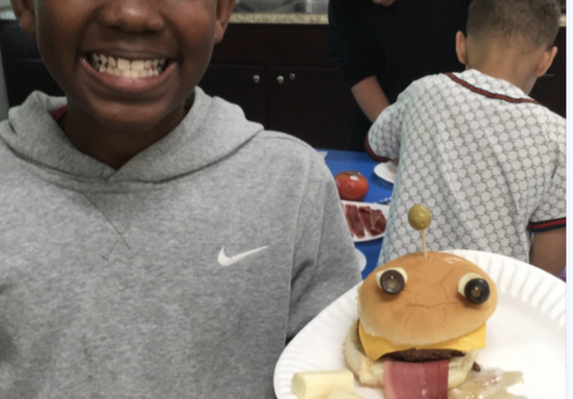 boy with hamburger that looks like a face